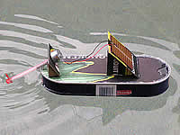 A classic Solarboat made out of fish can cucumber carton Photovoltaic cell elektromotor straw and screw